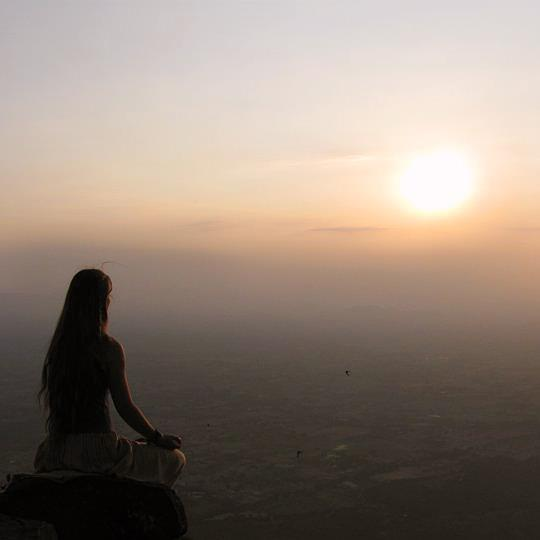 meditation at sundown on a cliff